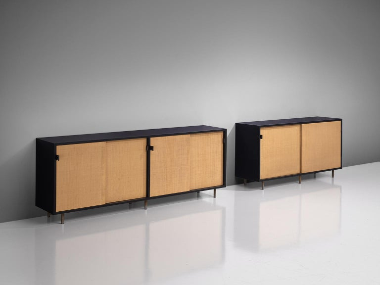 Florence Knoll for Knoll, pair of sideboards, cane, ebonized wood, and metal, United States, 1961.