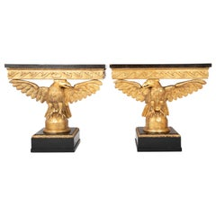 Pair of Early to Mid-19th Century Giltwood Eagle Console Tables