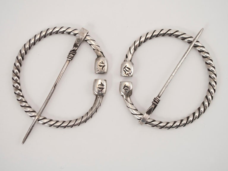 Pair of early to Mid-20th century silver tribal fibulae, Berber People, Tunisia  This beautiful pair of Berber fibulae would have been used to attach a shawl to a woman's dress. There is a lovely, soft patina from years of wear.     .