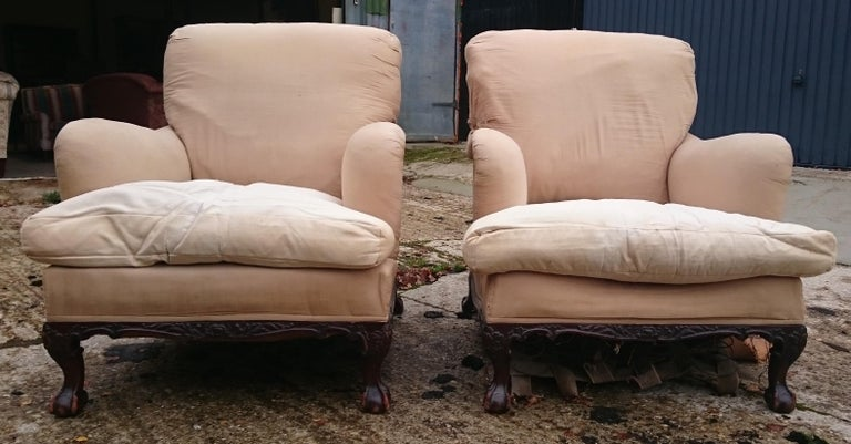 Pair of Easy Armchairs Made by Howard and Sons of London In Distressed Condition For Sale In Gloucestershire, GB