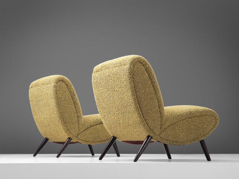 Norman Bel Geddes, set of two slipper chairs, fabric and beech, United States, 1949.  Set of two easy chairs designed by the American Industrial designer Norman Bel Geddes (1893-1958). In his book 'Horizons' (1932) he describes his design