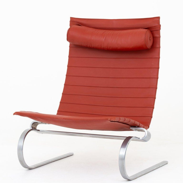 Pair of PK 20 - Easy chairs with red leather on a frame of steel. Maker Fritz Hansen.
