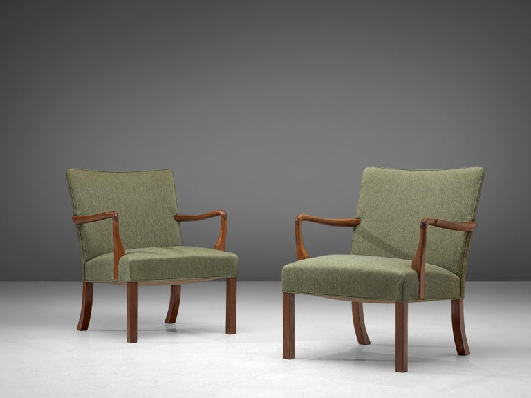 Jacob Kjær, pair of armchairs, mahogany and fabric, Denmark, 1940s.  Stunning pair of armchairs by master cabinetmaker Jacob Kjaer. Characterized by simplicity, the chairs are executed in the finest materials, such as mahogany. Kjaer was inspired by