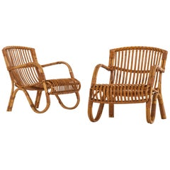 Pair of Easy Chairs in Rattan and Cane by E.V.A. Nissen & Co in Denmark