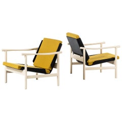 Pair of easy chairs in white and black lacquered wood produced in Denmark