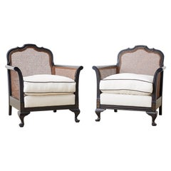 Pair of Ebonized Cane Bergere Lounge Chairs with Linen