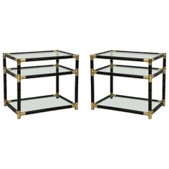 Pair of ebonized faux-bamboo and bronze three-tiered tables in the Billy Haines