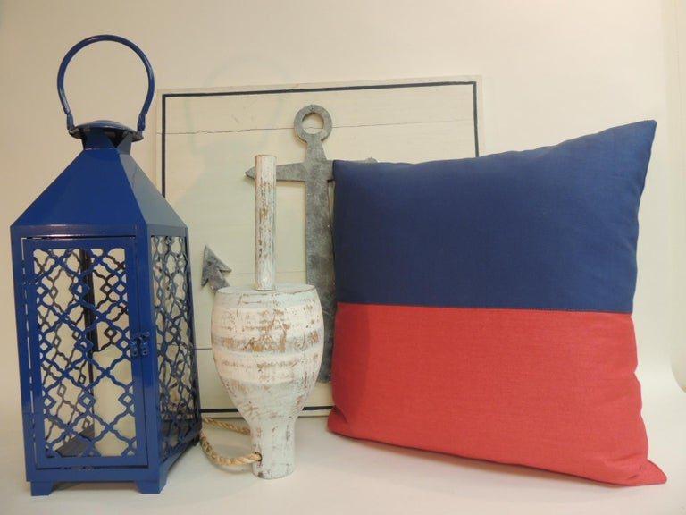 Red and blue nautical flag inspired square decorative pillows. Doubled sided, red linen and heavy cotton blue fabrics. Decorative pillows handcrafted and designed in the USA. Closure by stitch (no zipper closure) with custom made pillow