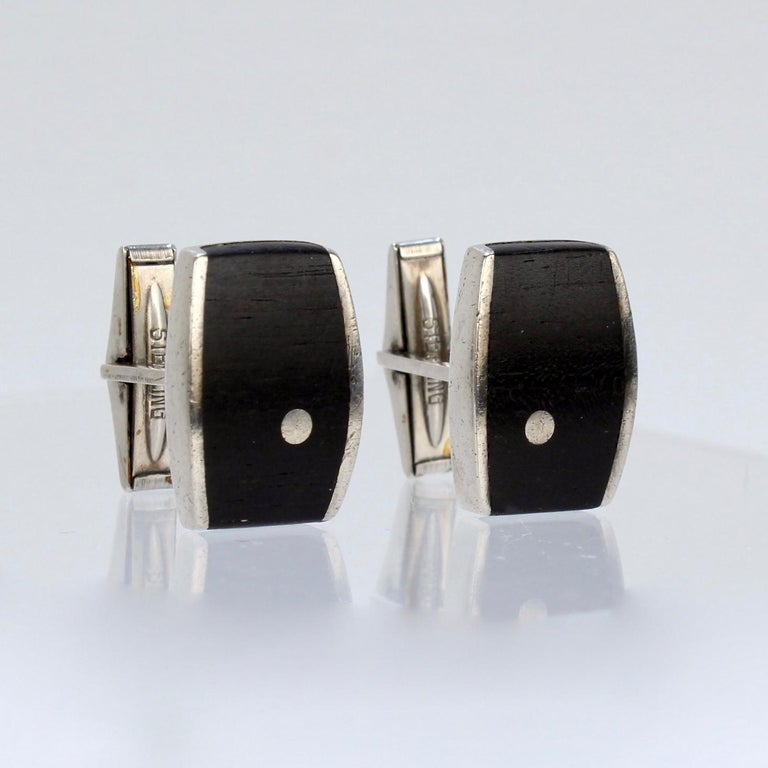 A superb pair of Ed Weiner cufflinks.  In sterling silver with inlaid ebony wood.  Marked: Sterling for silver fineness and Ed Wiener.  Great cufflinks from the renowned New York modernist jewelry maker!  Height: ca. 24mm Width: ca. 15mm  Items