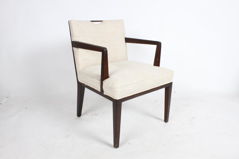 Listed are a pair of elegant Edward Wormley for Dunbar dining chairs with arms and brass handles. These are in need of restoration, perfect if your looking to add to your set. Also can be used as occasional chairs. Model 4710A, unmarked.