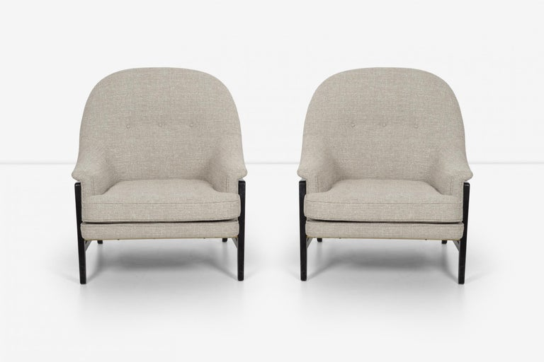 Pair of Edward Wormley Janus collection lounge chairs and ottomans for Dunbar, model 5701 walnut frames with brass hardware, reupholstered with Holly Hunt Great Plains cotton-poly fabric. 