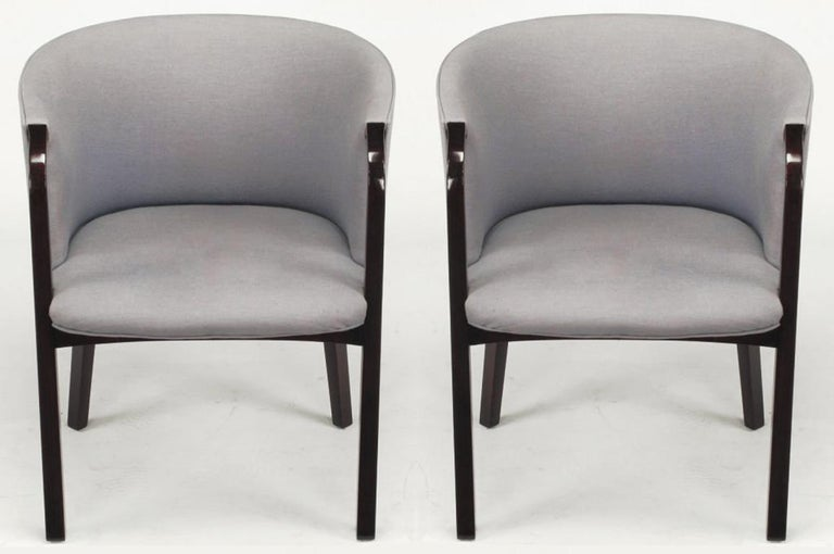 Edward Wormley for Dunbar barrel back arm chairs in mahogany and blue/gray wool upholstery. Great understated design that reveals unique qualities, would make great desk chairs as well as small lounge chairs.