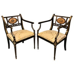 Pair of Edwardian Black Lacquered and Gilt Highlighted Elbow Chairs with Cane