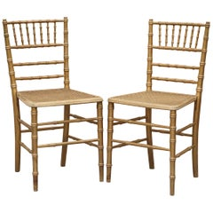 Pair of Edwardian Giltwood Famboo Regency Style Berger Chairs with Gold Gilding