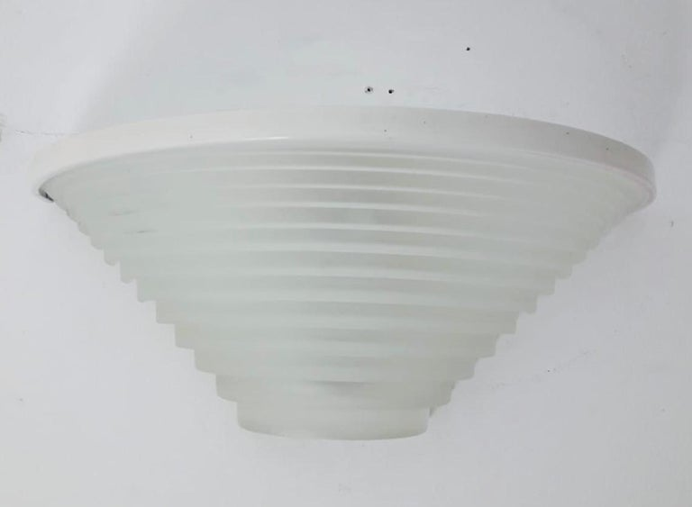 Italian vintage wall lights with white sanded glass shade on painted metal frame / Designed by Angelo Mangiarotti for Artemide, circa 1980s, made in Italy Original label on the frame 2 lights / E26 or E27 type / Max 100W each Measures: Width 15