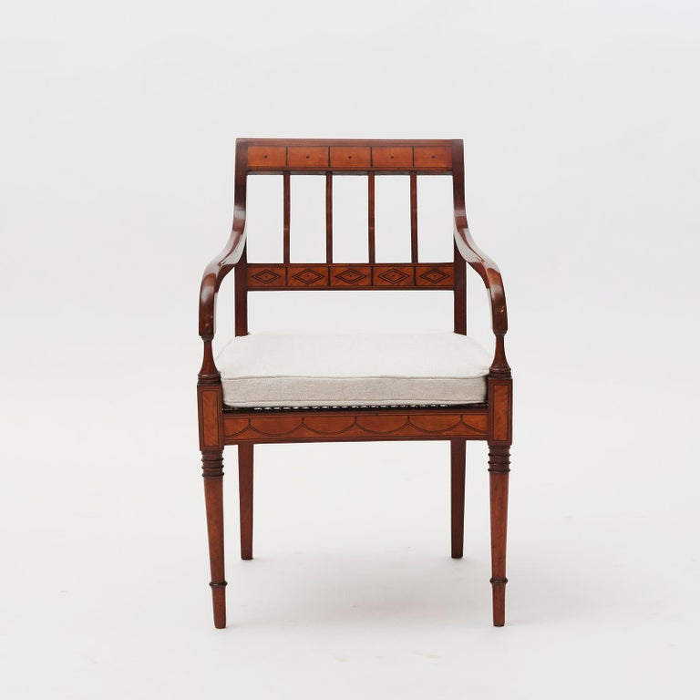 Elegant and decorative pair of Danish Empire armchair, made of mahogany, veneered with birch in fields, streaky arsenic in ebony. Seats with original wicker and new seat cushions.