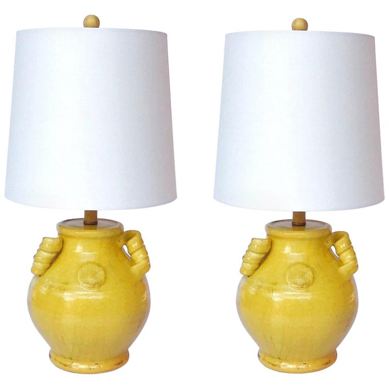 Pair of Elegant Chinese Pottery Lamps in Antique Yellow Glaze For Sale