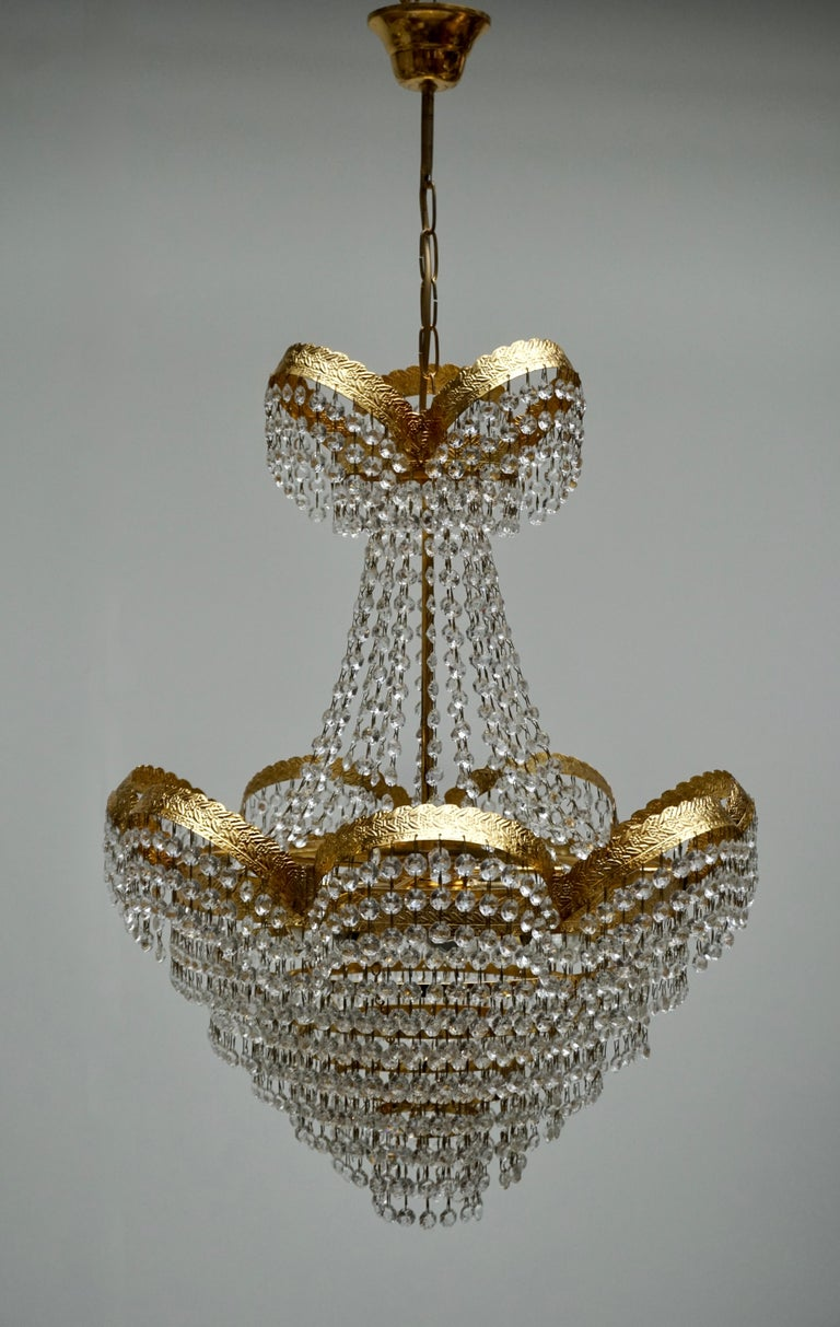 20th Century One Elegant Crystal and Brass Chandelier For Sale