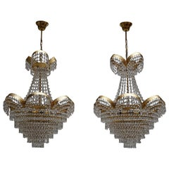 One of >Two Elegant Crystal and Brass Chandeliers