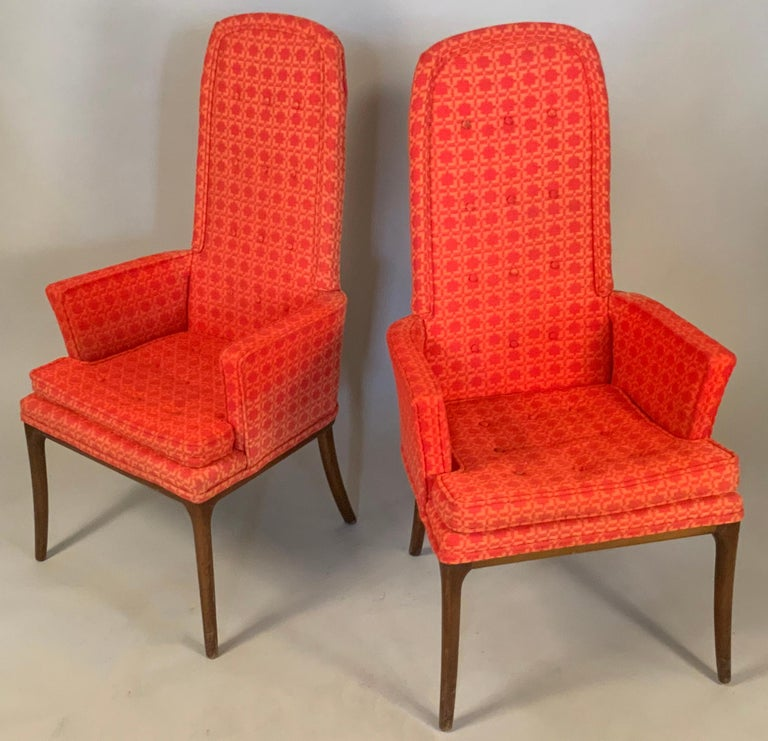 A pair of very elegant high back armchairs designed by Erwin-Lambeth. With tall slim curved top backs, and slim arms, raised on elegant slightly curved tall legs. Beautiful design and scale. In their original red patterned fabric which shows average