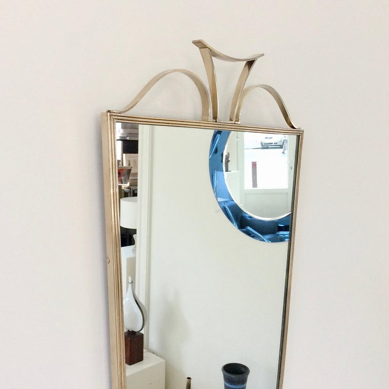 Polished Pair of Elegant Italian Brass Wall Mirrors, circa 1950 For Sale