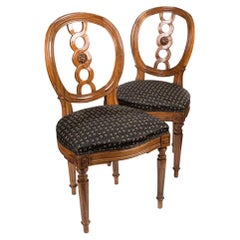 Pair of Elegant Louis-Seize Chairs, France, circa 1760, Walnut, carved,