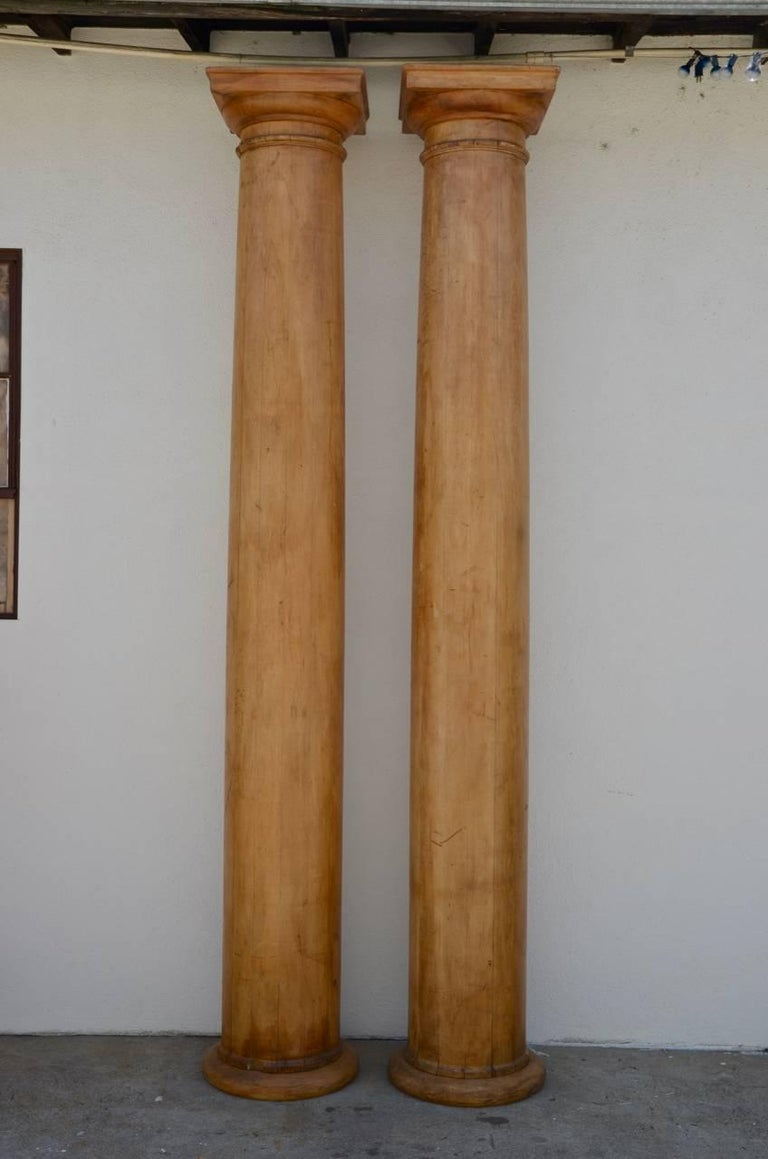 Pair of elegant 10 feet tall fluted decorative pine columns. Stunning.