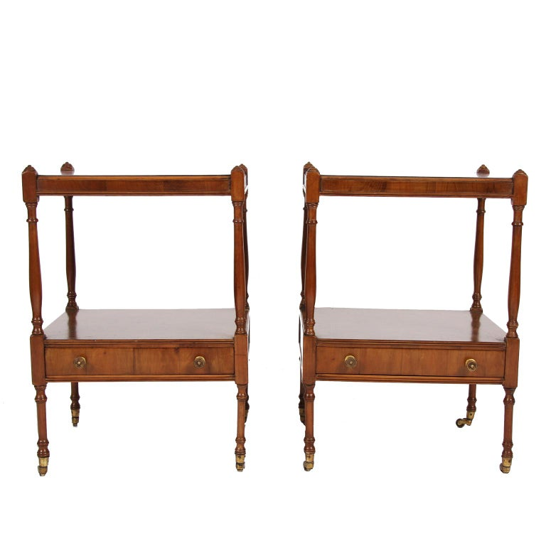 English early 20th century  An elegant pair of elm bedside tables. With a lovely grain to the wood and brass castors.