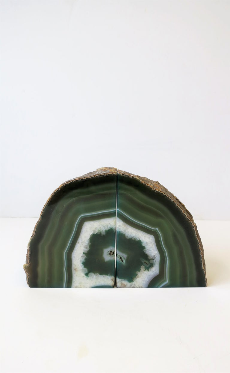 A beautiful and substantial pair of emerald green and white onyx bookends or decorative objects.   Measurements: 6.38 in. H x 4.75 in. W.
