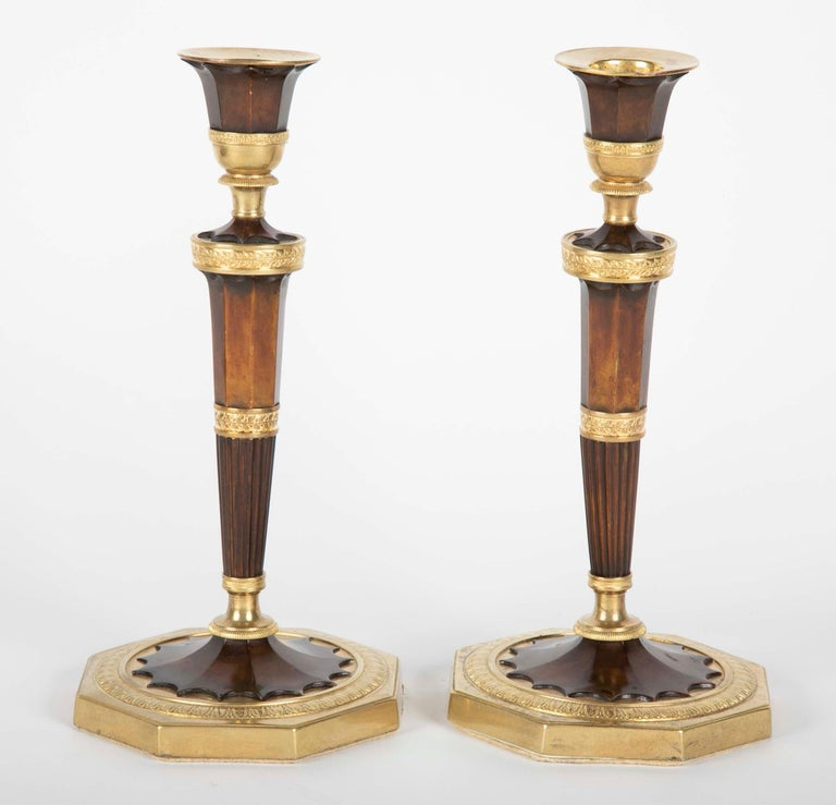 A pair of French gilt bronze candlesticks.
