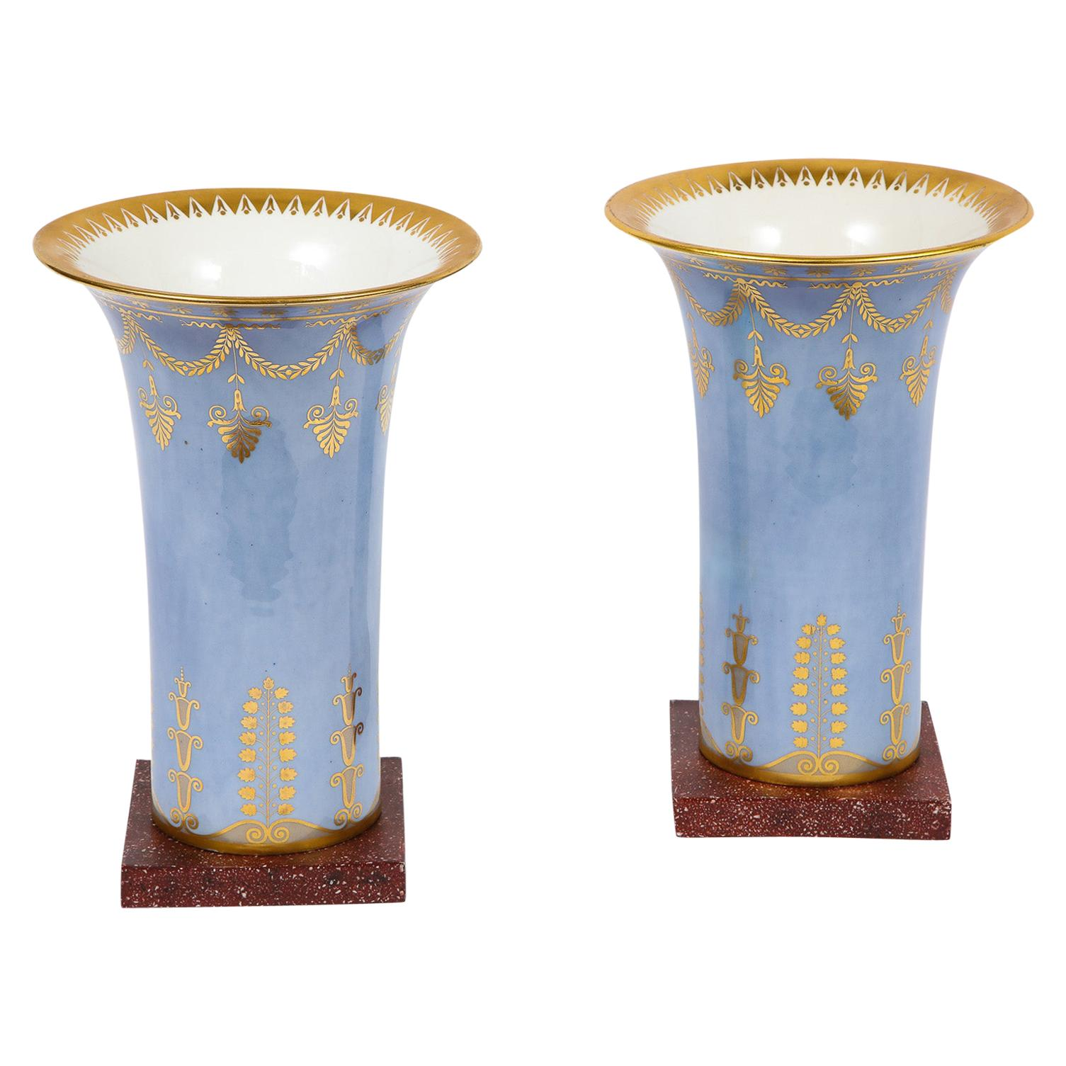 Pair of Empire Period Sèvres Porcelain Pale Blue and Faux Porphyry Ground Vases