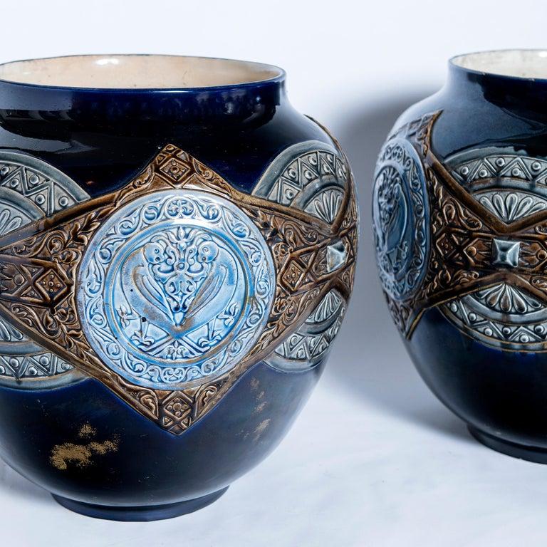 Pair of enamel ceramic planters, France, late 19th century.