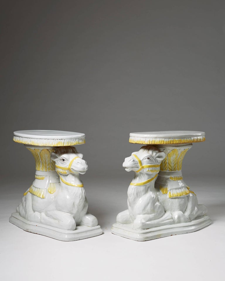 Pair of end tables anonymous Italy, retailed by Svenskt Tenn. Sweden, 1950s. Hand-glazed terracotta.  Measures: H: 57 cm/ 22 1/2''. L: 65 cm/ 25 1/2''. D: 33 cm/ 13''.  Sold as a pair.