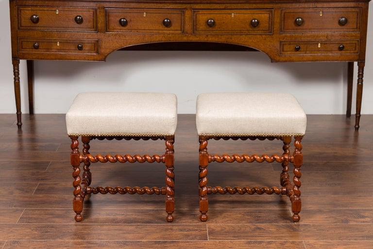Brass Pair of English 1860s Walnut Stools with Barley Twist Base and New Upholstery For Sale