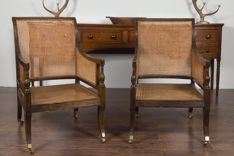 Pair of English 1870s Cane and Oak Library Chairs with Cushions and Casters For Sale 5