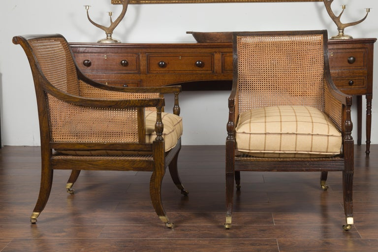 Pair of English 1870s Cane and Oak Library Chairs with Cushions and Casters For Sale 9