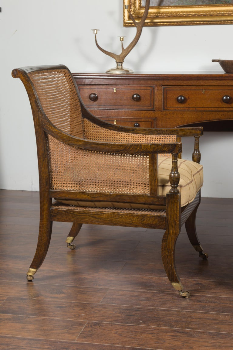 Pair of English 1870s Cane and Oak Library Chairs with Cushions and Casters For Sale 10
