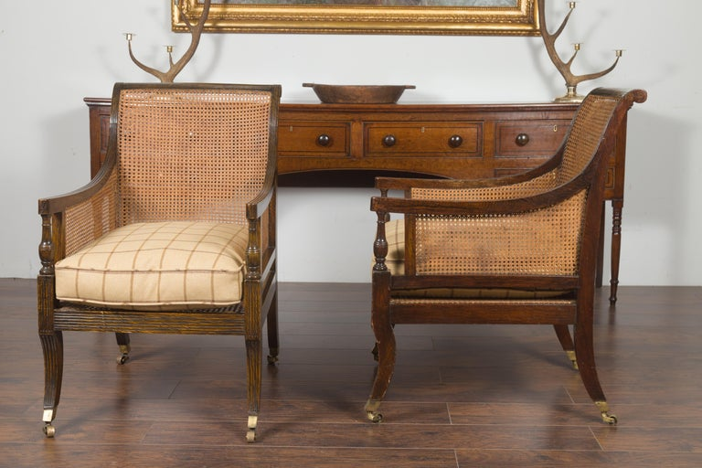 Pair of English 1870s Cane and Oak Library Chairs with Cushions and Casters For Sale 11