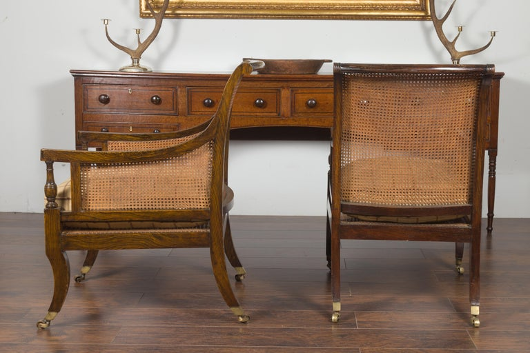 Pair of English 1870s Cane and Oak Library Chairs with Cushions and Casters For Sale 12