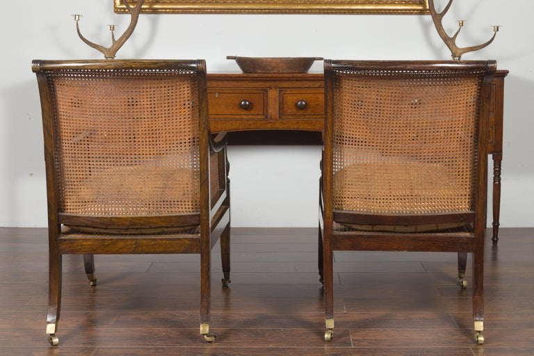 Pair of English 1870s Cane and Oak Library Chairs with Cushions and Casters For Sale 13
