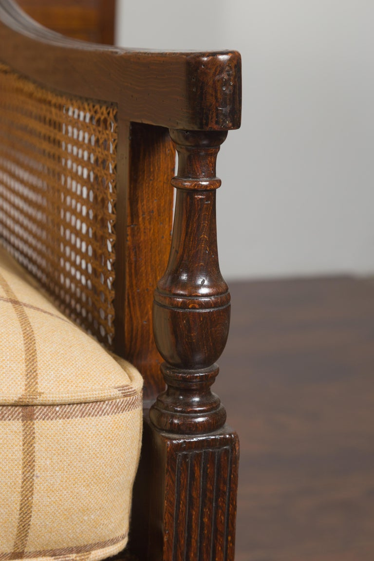 Pair of English 1870s Cane and Oak Library Chairs with Cushions and Casters For Sale 2