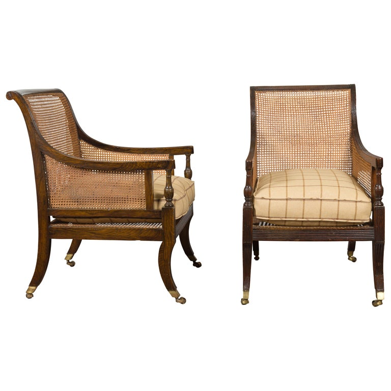 Pair of English 1870s Cane and Oak Library Chairs with Cushions and Casters For Sale