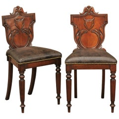 Pair of English 1880s Carved Oak Hall Chairs with Leather Upholstered Seats
