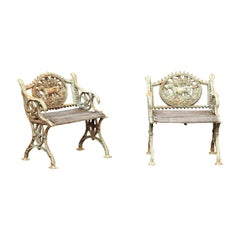 Pair of English 1890s Painted Iron Garden Chairs with Dogs, Birds and Foliage