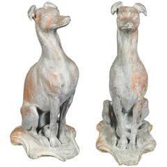 Pair of English 1940s Lead Whippet Dog Sculptures on Scrolling Cartouches
