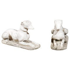 Pair of English 19th Century Carved Stone Reclining Dogs with Weathered Patina
