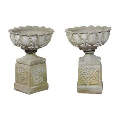 Pair of English 20th Century Stone Urns on Pedestals with Acanthus Leaf Motifs