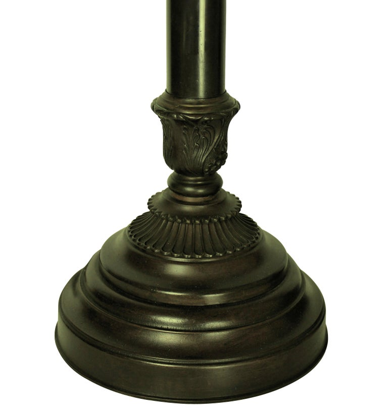 A pair of English bronzed metal table lamps of a neoclassical design.