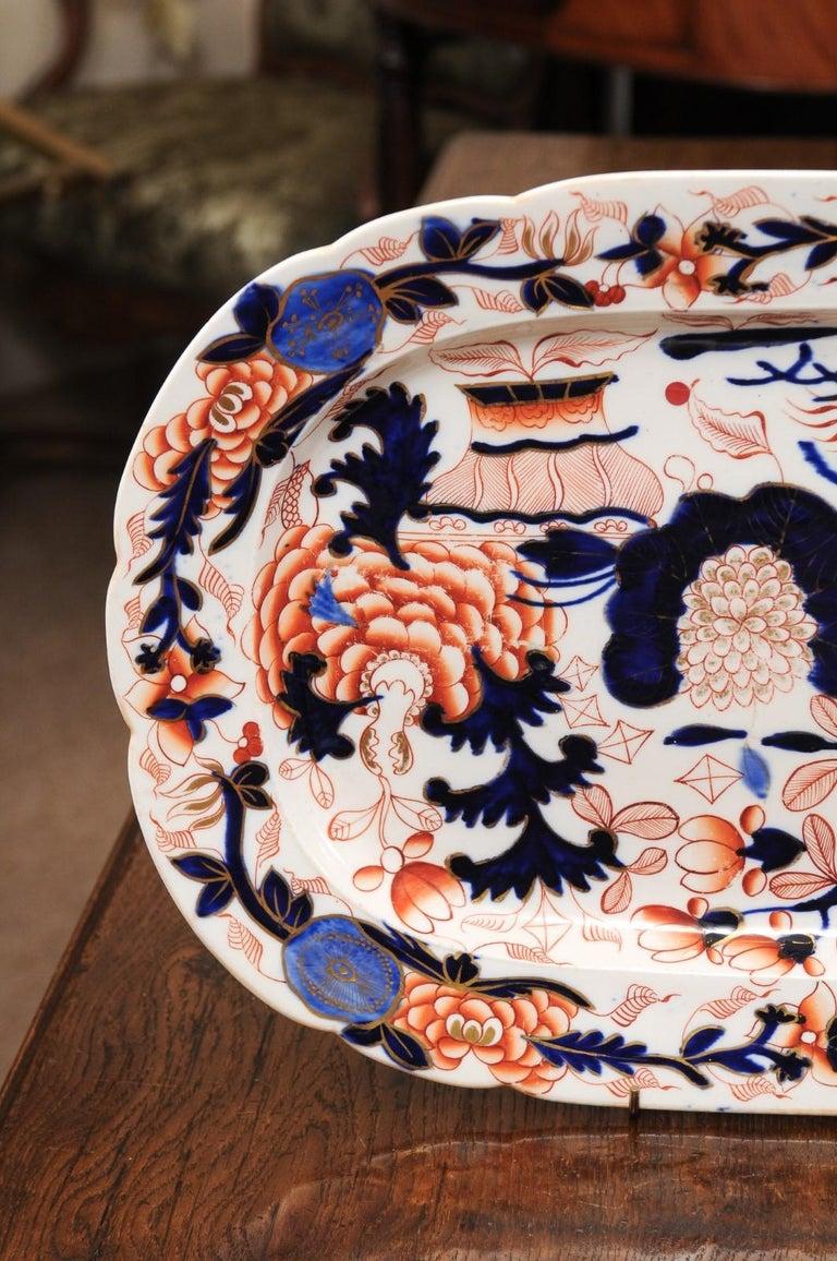 The English pair of coalport platters in the Imari hues, dating circa 1840.