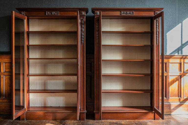 Pair of English country house solid mahogany glazed bookcases,